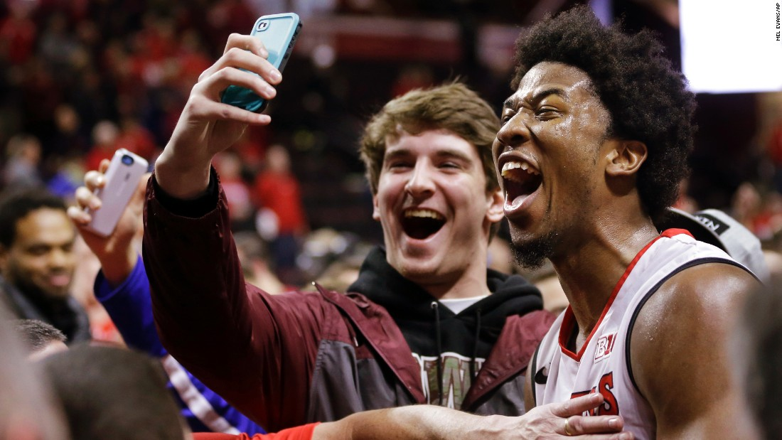 A fan gets a selfie with Rutgers basketball player Kadeem Jack on Sunday, January 11, after Rutgers defeated Wisconsin in Piscataway, New Jersey.