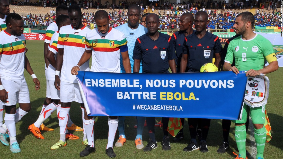Mali and Algeria players hold a banner uniting against Ebola during a Africa Cup of Nations qualifying match in November.