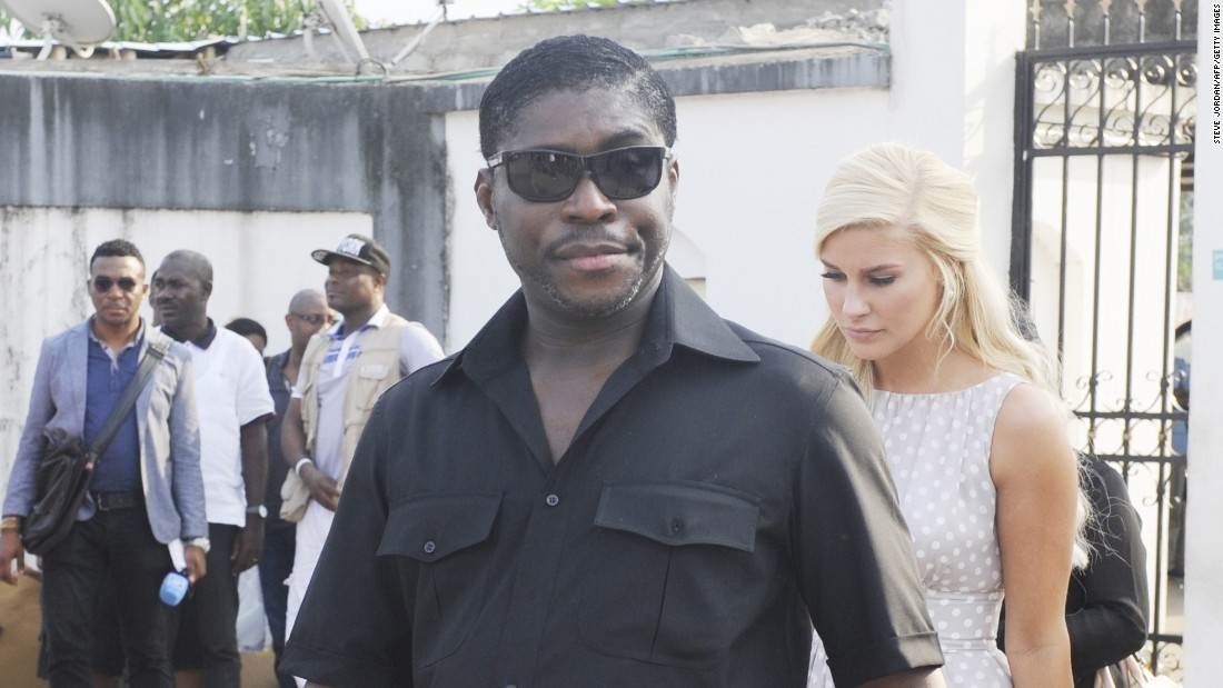 President Obiang's son, Teodorin, is pictured with girlfriend Christina Mikkelsen during a distribution of toys to disadvantaged children in Malabo in December.
