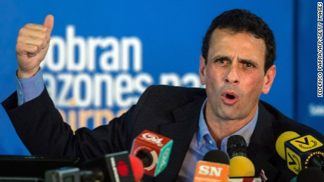 Miranda state governor and opposition leader Henrique Capriles Radonski speaks during a press conference in Caracas on January 14, 2015. The Venezuelan opposition leader Henrique Capriles announced Wednesday that the opposition coalition Mesa de la Union Democr�tica (MUD) will be reorganized in vue of the economic crisis and facing the legislative elections of 2015. AFP PHOTO/FEDERICO PARRA (Photo credit should read FEDERICO PARRA/AFP/Getty Images)
