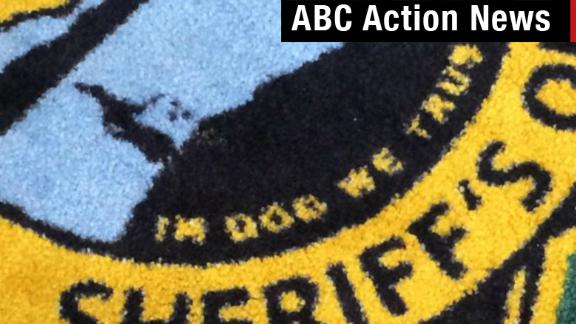 Sheriff's carpet: In Dog We Trust