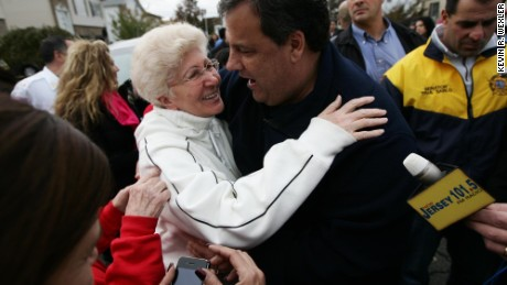 New Jersey Gov. Chris Christie (R) hugs Angela Cimillo of Moonachie, New Jersey whose home was damaged by Superstorm Sandy November 1, 2012 in Moonachie, New Jersey. With the death toll currently over 70 and millions of homes and businesses without power, the US east coast is attempting to recover from the effects of floods, fires and power outages brought on by Superstorm Sandy.