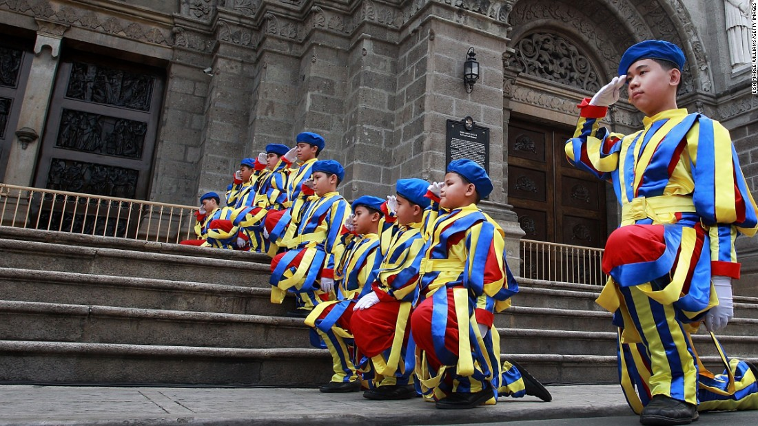 Young boys dressed as Swiss Guards rehearse at the steps of the Manila Cathedral ahead of the papal visit to the area on January 14.