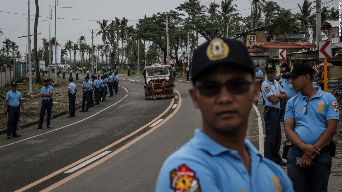 Police line a road in Tacloban, Leyte as they rehearse security procedures ahead of the visit of Pope Francis on January 14.