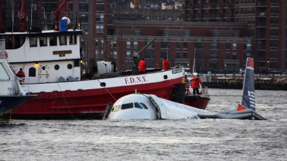 NEW YORK - JANUARY 15:  A New York City Fire Department boat floats next to a US Airways plane floating in the water after crashing into the Hudson River in the afternoon on January 15, 2009 in New York City. The Airbus 320 flight 1549 crashed shortly after take-off from LaGuardia Airport heading to Charlotte, North Carolina.   (Photo by Jerritt Clark/Getty Images)