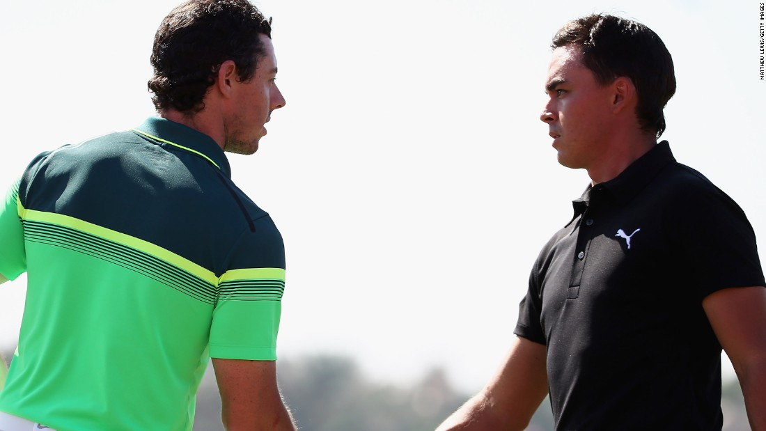 McIlroy shakes hands with his great rival  Fowler of the United States at the end of a first round in which they both shot five-under 67 but trailed Kaymer by three shots.
