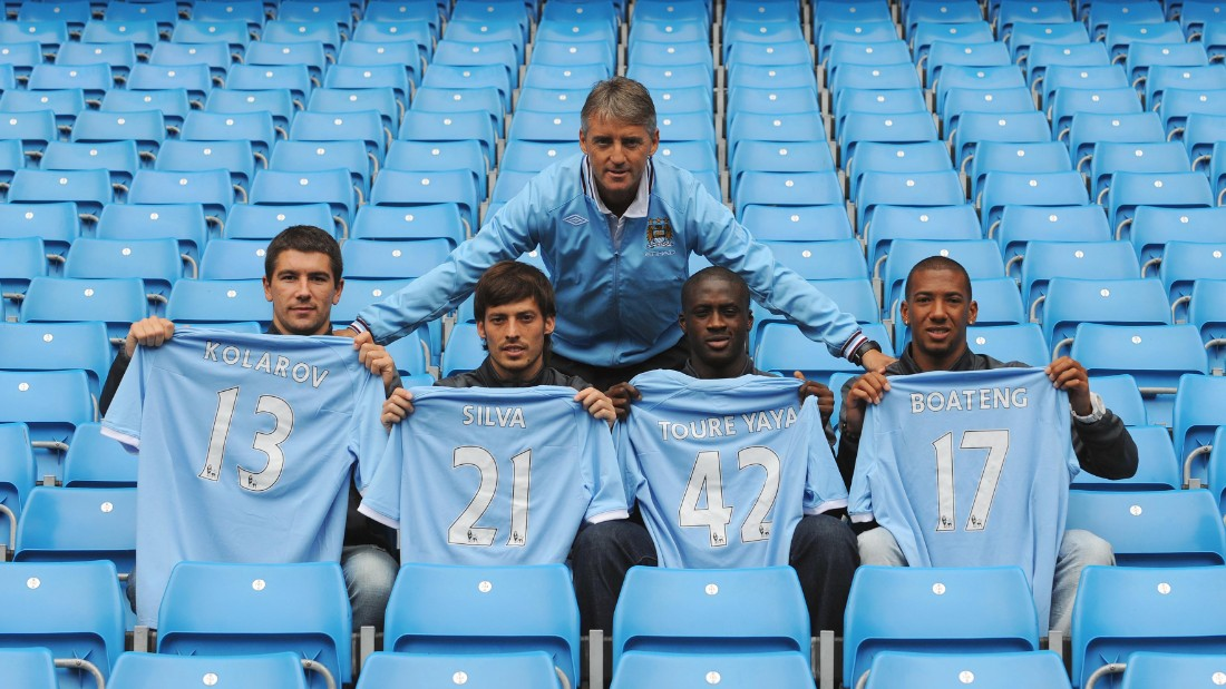 Shortly after the World Cup he was among a raft of new signings under Roberto Mancini for Manchester City. Toure was unveiled alongside Aleksandar Kolarov, David Silva and Jerome Boateng.