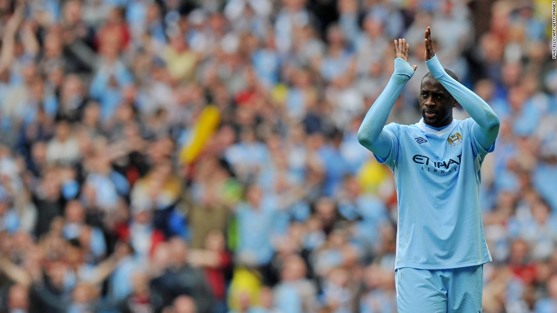 Toure applauds the Manchester City support as the club finally end their wait for the Premier League title in the most dramatic of circumstances, courtesy of Sergio Aguero's late goal to defeat QPR 3-2 in the final seconds of the 2011-12 season.