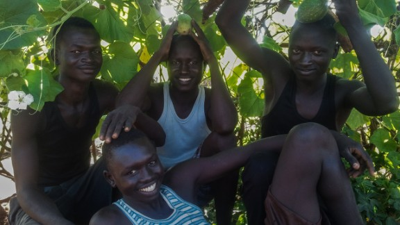 """<br />""""These four boys live alone on their compound with nobody to help them cook, clean, fetch water and firewood. They usually cooperate and get along to work together. They've planted pumpkins on their compound that are now ready for harvest."""""""
