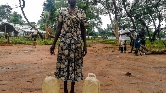 """<br />""""She brought water from a distance, until she was tired. That is why she is resting. Water is fetched for cooking and keeping homes clean. But the problem is that people need bigger jerry cans, these small ones don't help much."""""""