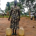 South Sudan refugee stories Awatif water cans