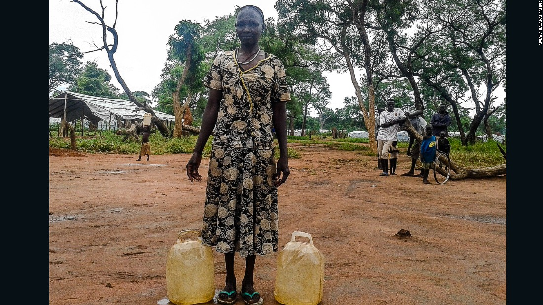 "<br />""She brought water from a distance, until she was tired. That is why she is resting. Water is fetched for cooking and keeping homes clean. But the problem is that people need bigger jerry cans, these small ones don't help much."""