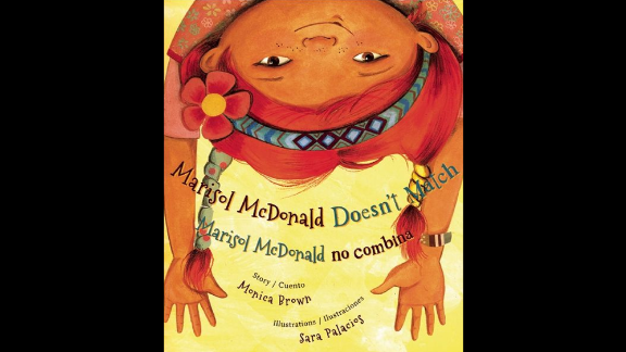 """""""Marisol McDonald Doesn't Match/Marisol McDonald no combina,"""" written by Monica Brown and illustrated by Sara Palacios, tells the story of a girl with red hair and brown skin, a Peruvian-Scottish-American who is perfectly happy the way she is."""