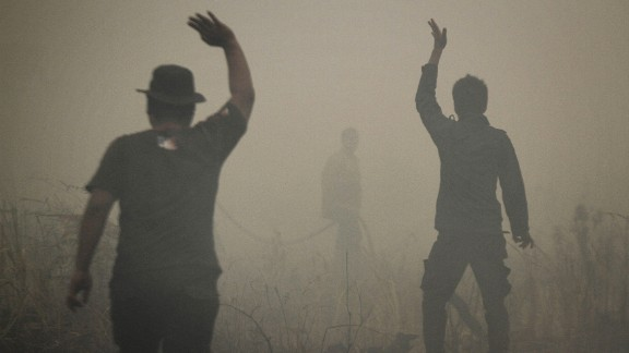 Indonesian firefighters put out a fire on smoldering peatland in Siak Regency located in Riau province on Indonesia