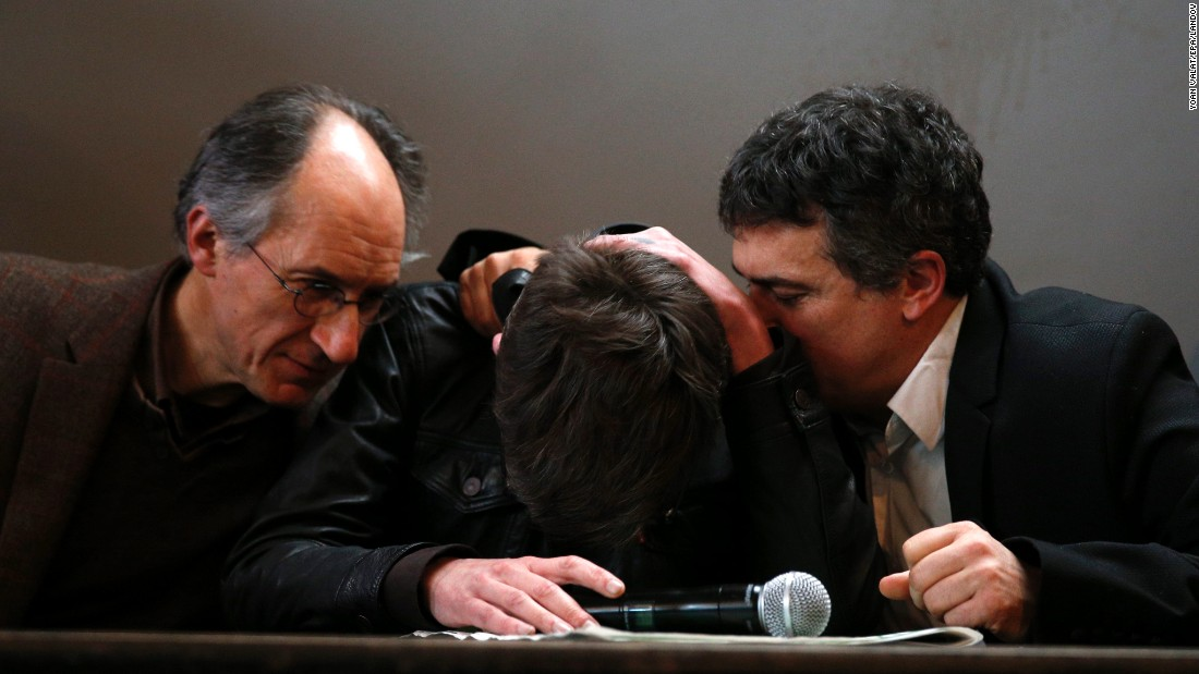 "Luz, a cartoonist for Charlie Hebdo magazine, is comforted by journalist Patrick Pelloux, right, and Charlie Hebdo Editor-in-Chief Gerard Biard during a news conference in Paris on Tuesday, January 13. Twelve people were killed in <a href=""http://www.cnn.com/2015/01/07/world/gallery/paris-charlie-hebdo-shooting/index.html"" target=""_blank"">a terror attack on the magazine's office</a> on January 7."