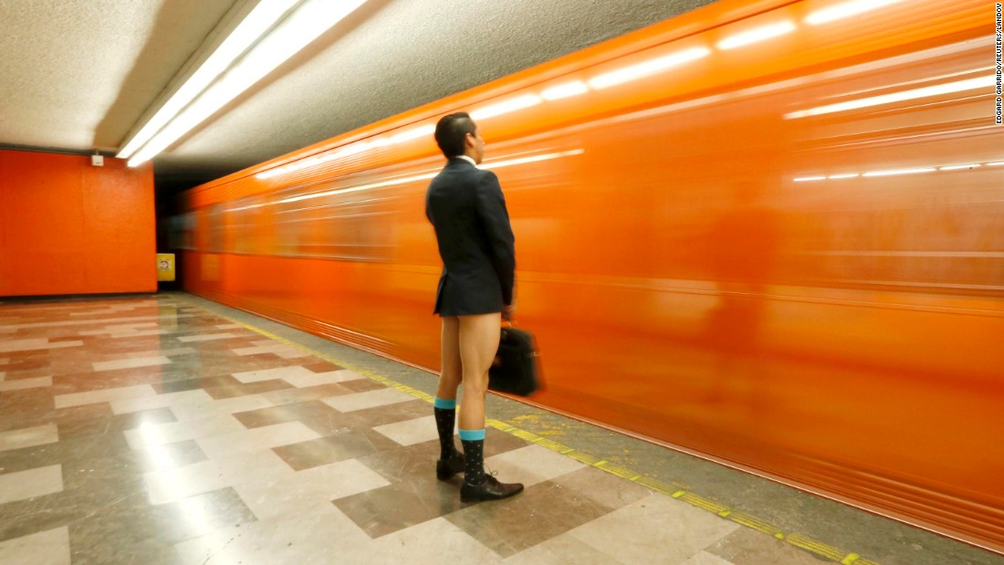 "In this long-exposure photo, a traveler without pants waits for a train Sunday, January 11, during the ""No Pants Subway Ride"" in Mexico City. The annual event also occurs in other cities around the world, including New York."
