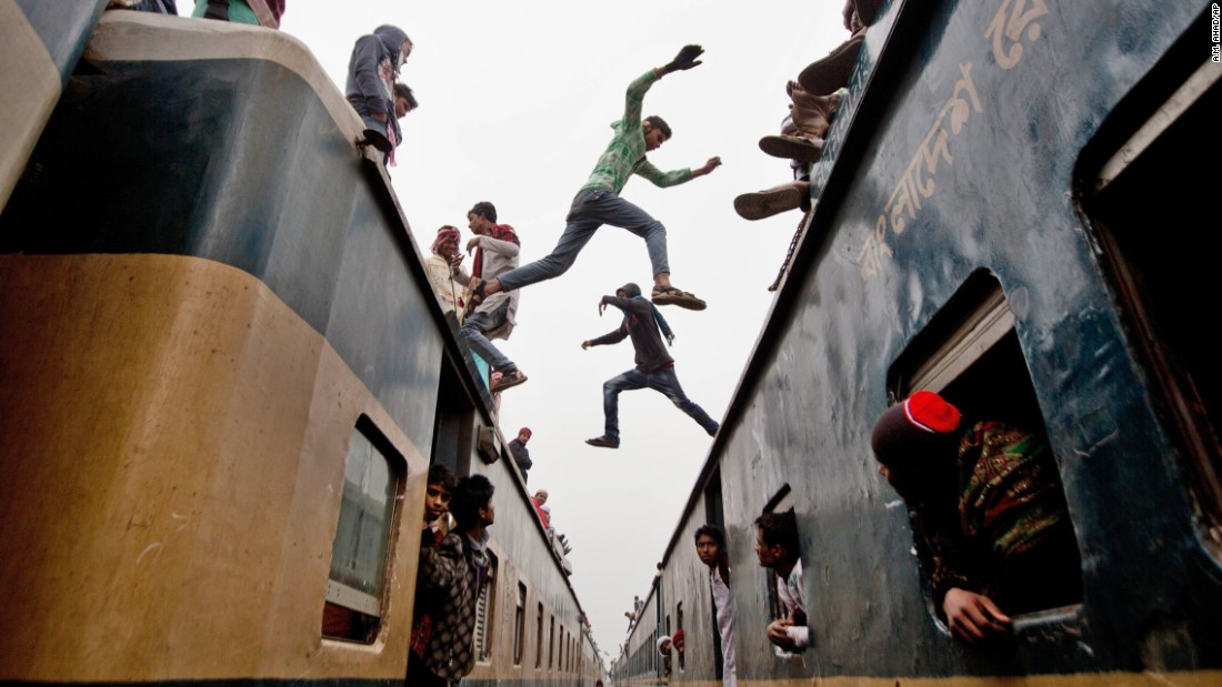 Boys in Tongi, Bangladesh, jump from one overcrowded train to another on Sunday, January 11. Thousands of Bangladeshi Muslims were trying to return home after attending the Islamic Congregation, a three-day religious gathering.