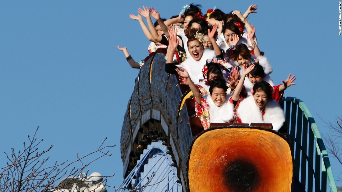 Japanese women wearing kimonos ride a roller coaster at a Tokyo amusement park during a Coming of Age Day celebration on Monday, January 12.