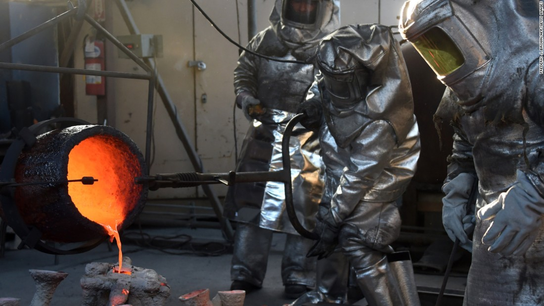 Workers in Burbank, California, pour hot molten bronze on Tuesday, January 13, as they make a statuette for the upcoming Screen Actors Guild Awards.