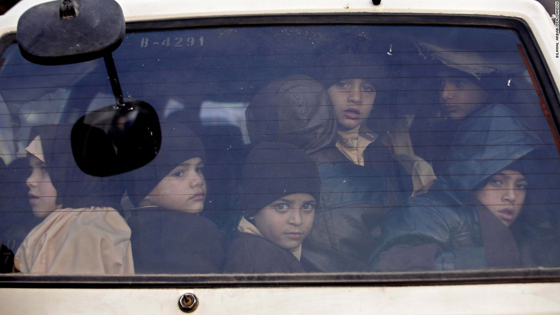 "Children leave their school in Peshawar, Pakistan, after it was reopened on Monday, January 12. A month earlier, the school had closed after <a href=""http://www.cnn.com/2014/12/16/asia/gallery/taliban-attack-peshawar-school/index.html "" target=""_blank"">Taliban gunmen killed at least 145 people there. </a>"