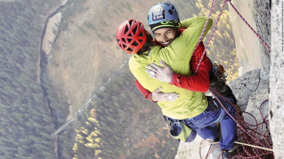 "Free climbers Tommy Caldwell, left, and Kevin Jorgeson embrace Wednesday, January 14, after reaching the top of El Capitan, a 3,000-foot rock formation in California's Yosemite National Park. They are <a href=""http://www.cnn.com/2015/01/14/travel/gallery/el-capitan-climbers/index.html"" target=""_blank"">the first to successfully climb El Capitan's Dawn Wall</a> using only their hands and feet."