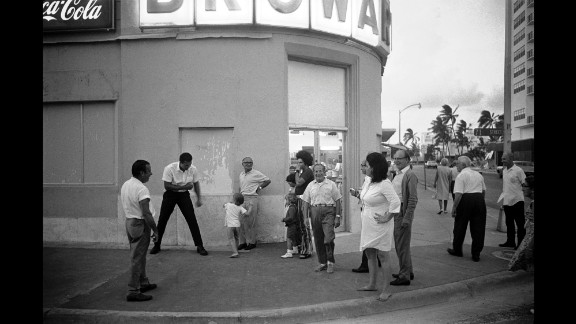 Ali horses around with a child on a street corner in Miami Beach, Florida. He was in town to train for his second fight against Jerry Quarry.
