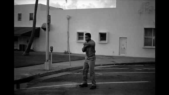 Ali shadowboxes at dawn.