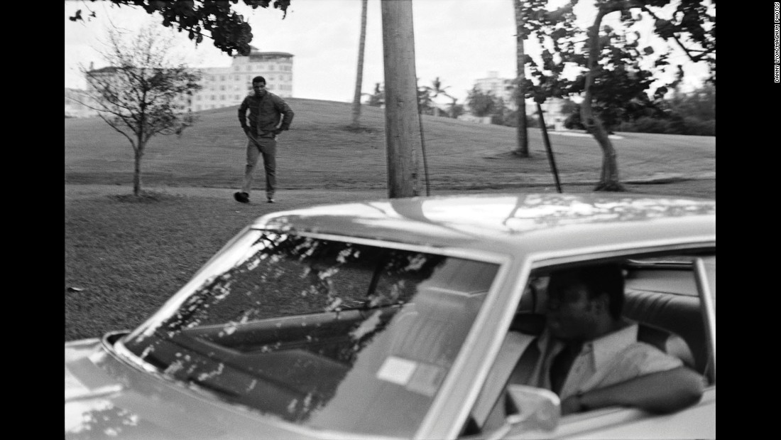 Ali cools down after running at dawn. In the car is Bundini Brown, his longtime friend and cornerman.