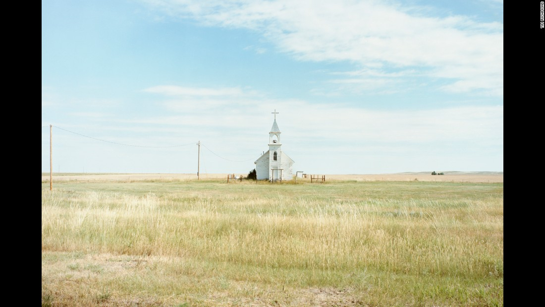 "A church stands on the Oglala Sioux Reservation in South Dakota. ""When you're traveling 50 miles between almost just a gas station and that's it, it sort of changes one's viewpoint of scale and distance,"" said Richmond."
