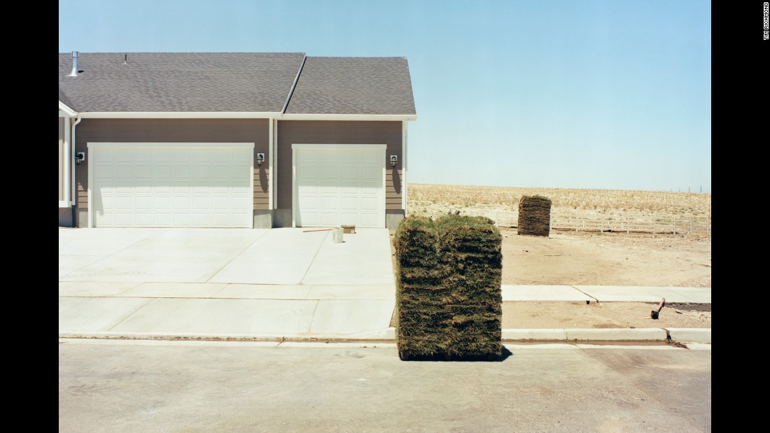 Sod is piled outside a home in Santaquin, Utah.