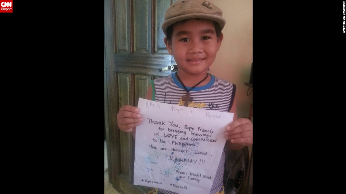 """Gee Eecchh Kyu"" and her family will be attending the Pope's mass in Manila. Her son, 5-year-old Khalil Noah Macarat, holds the sign in the picture. ""We are so happy and blessed (that) he chose the Philippines for his visit!"" says ""Gee Eecchh Kyu."""