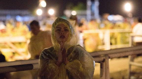 Thousands stood in the rain as the Pope conducted an outdoor Mass