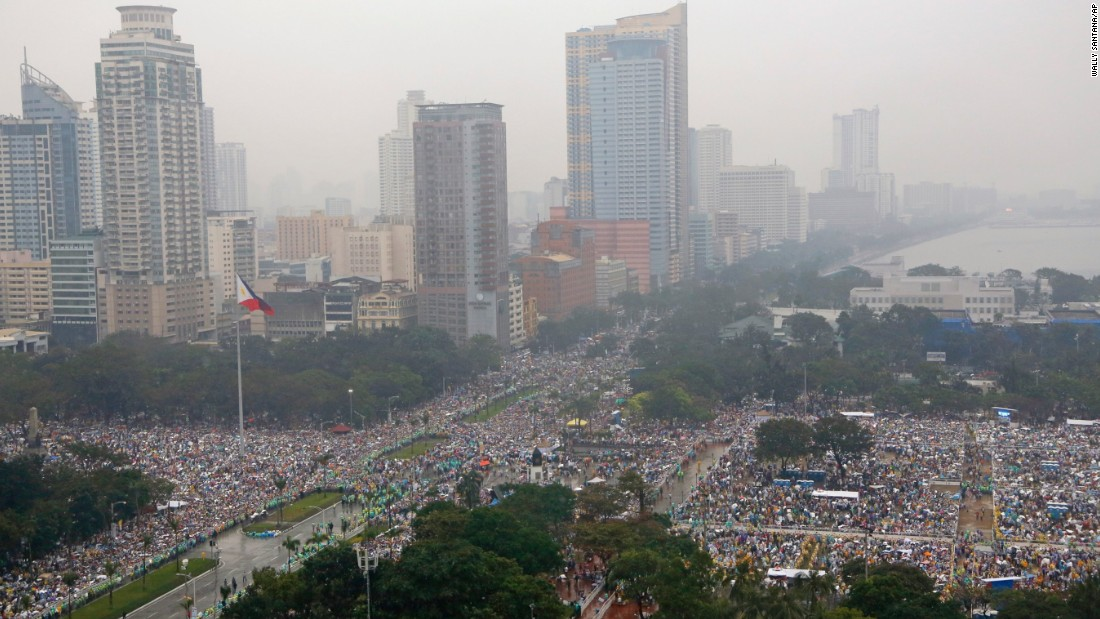 Millions brave the falling rain as they fill Rizal Park and the surrounding area in Manila on January 18 to hear Pope Francis celebrate Mass.