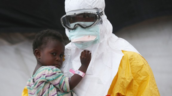 A Doctors Without Borders worker holds a child suspected of having Ebola in a treatment center in Liberia in October 2014.