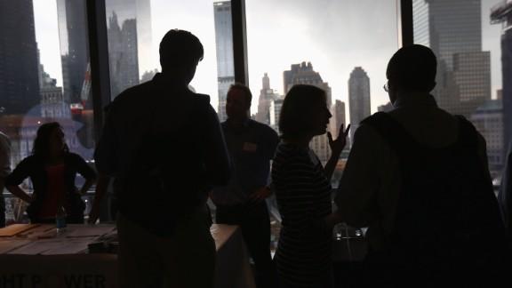 Job applicants meet potential employers at a job fair in New York City.