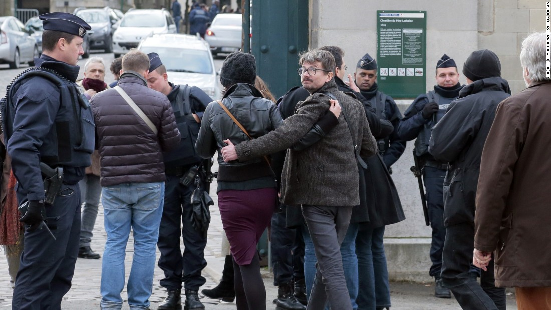 French cartoonist Renald Luzier, aka Luz, arrives at the Paris cemetery for Ourrad's funeral.