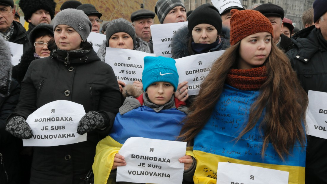 "People carry placards reading ''I am Volnovakha"" during the rally."