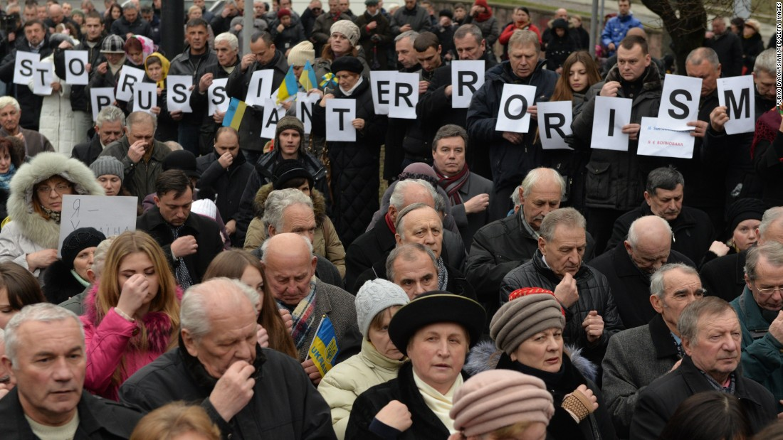 "People hold letters spelling out  ""STOP RUSSIAN TERRORISM"" during the rally."