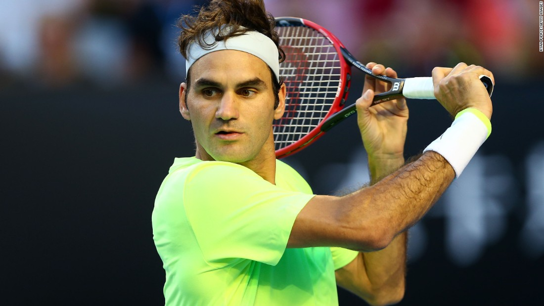 Roger Federer hits a slice against Yen-Hsun Lu. Federer was tested in the third set but prevailed 6-4 6-2 7-5.