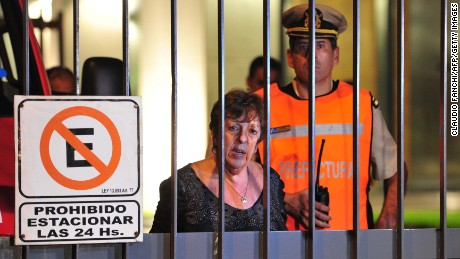 Picture released by Telam showing Argentine prosecutor Viviana Fein standing outside the flat where prosecutor Alberto Nisman, 51, was found dead, in the trendy Puerto Madero neighbourhood in Buenos Aires on January 19, 2015.