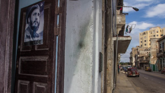A Fidel Castro poster is on the door but nearby alcoholics look for a fix of rum.