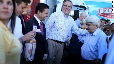 MIAMI, FL - DECEMBER 17: Former Florida Governor Jeb Bush hands out items for Holiday Food Baskets to those in need outside the Little Havana offices of CAMACOL, the Latin American Chamber of Commerce on December 17, 2014 in Miami, Florida. Mr. Bush spoke to the media as he handed out food to the annoucement that the United States and Cuba worked out a deal for the release of USAID subcontractor Alan Gross. (Photo by Joe Raedle/Getty Images)