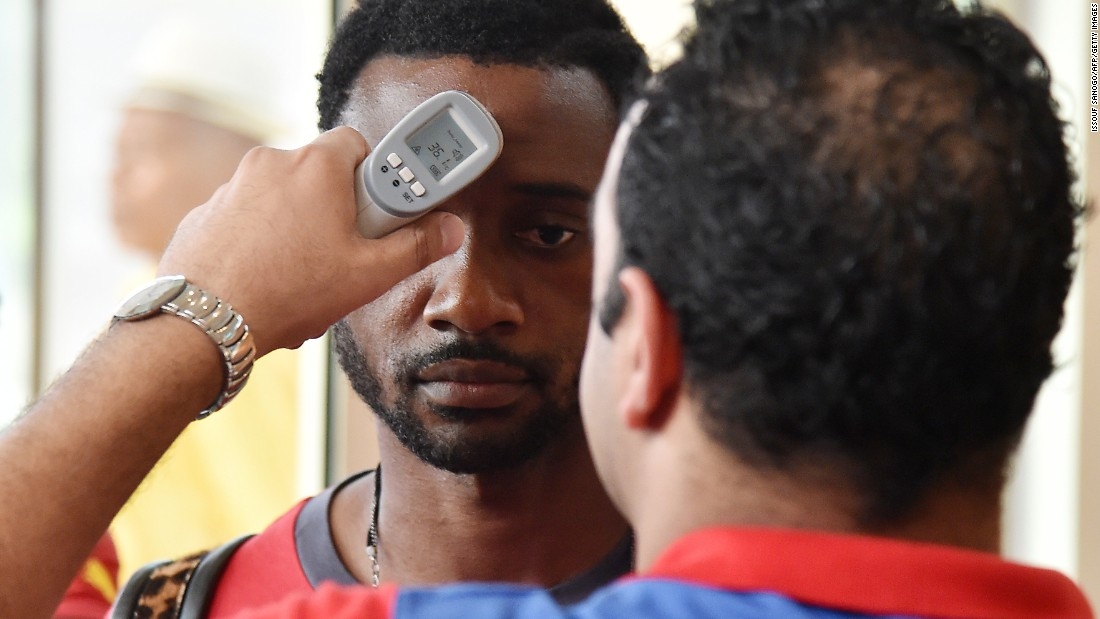 Concerns about the spread of Ebola means the Africa Cup players are tested when they land in Equatorial Guinea. Here Cameroon's defender Nicolas Nkoulou, who plays for Marseille, has his body temperature checked by a health worker at the airport.
