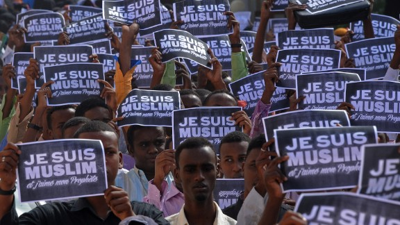 "Protesters hold signs which read ""I am a Muslim, and I love my prophet,"" in Mogadishu, Somalia, on Saturday, January 17."