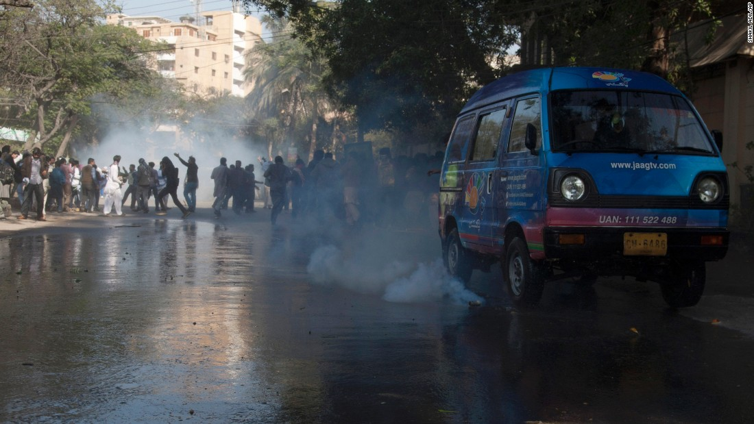 Police fire tear gas to disperse protesters in Karachi on January 16.