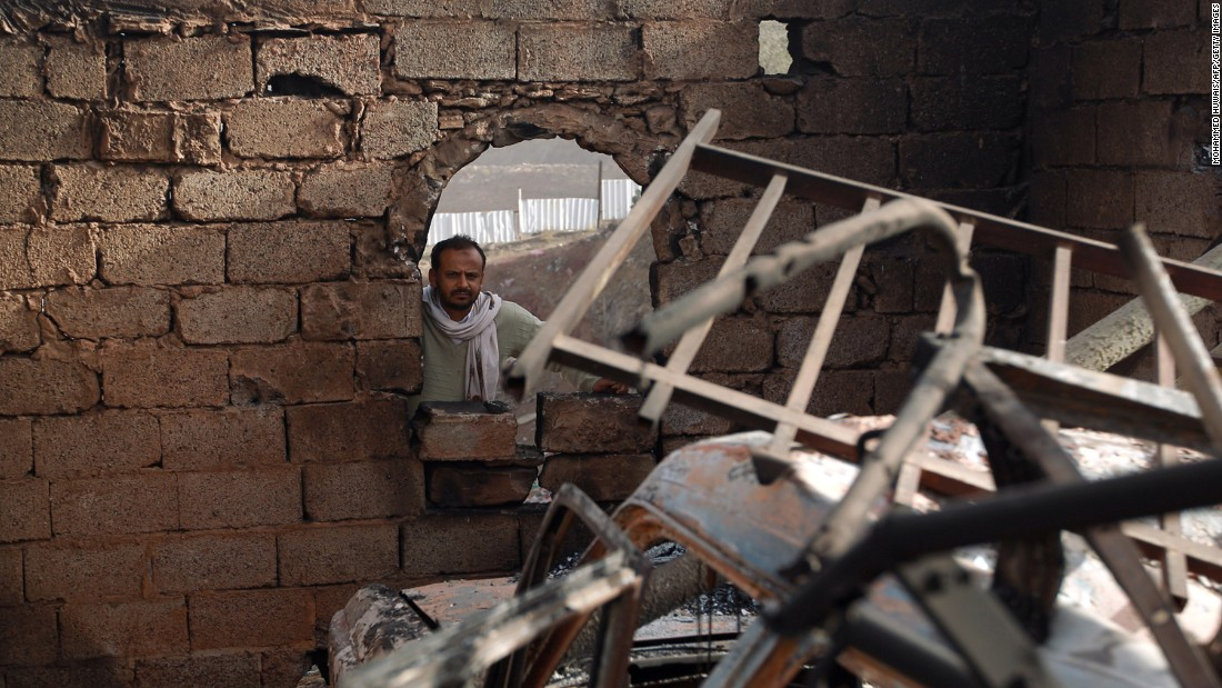 A man surveys his damaged home in Sanaa on January 20.