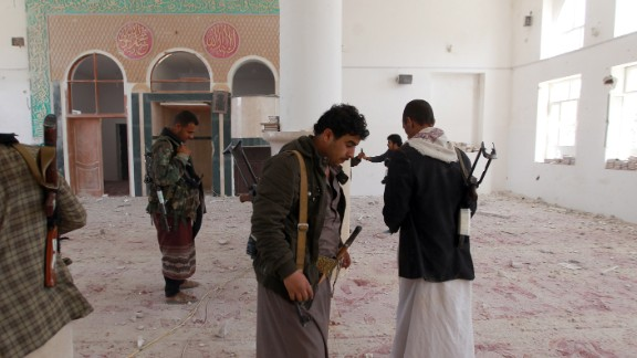 Houthis inspect a damaged mosque in Sanaa on January 20.