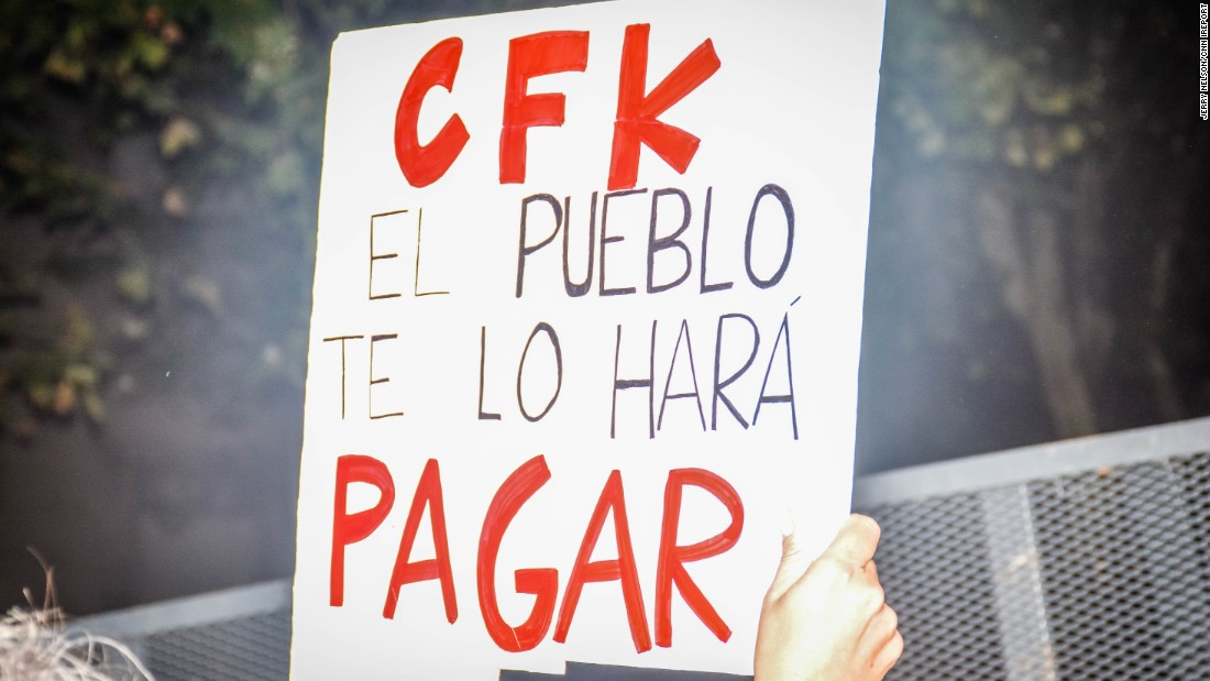 """CFK, the people will make you pay,"" reads a protester's sign, referring to President Cristina Fernandez de Kirchner. Nisman was set to testify on a report alleging that the President, Foreign Minister Hector Timerman and other officials had covered up Iran's involvement in the bombing of the Argentine Israelite Mutual Association building."