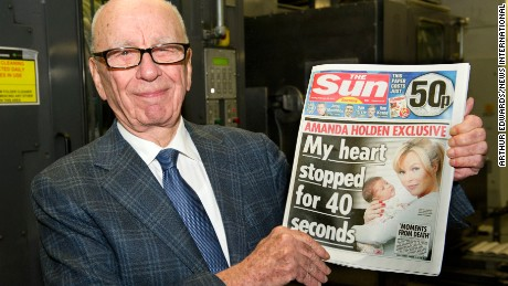 Rupert Murdoch, the owner of The Sun, poses with the first ever edition of The Sun on Sunday in February 2012.