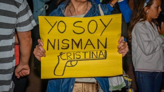 """I am Nisman,"" reads a protest sign."